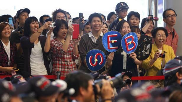 Fotografierende japanische Formel-1-Fans