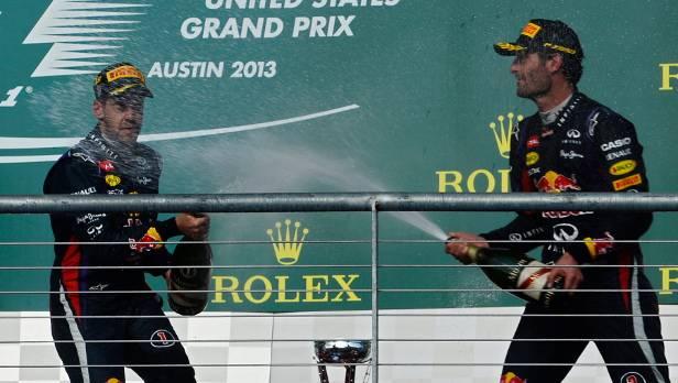 Diese Saison kein ungewöhnliches Bild: Vettel planscht im Champagner.