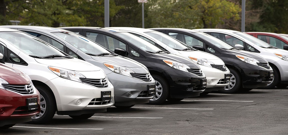 A line of new Nissan autos is seen outside a Nissan auto dealer in Broomfield, Colorado